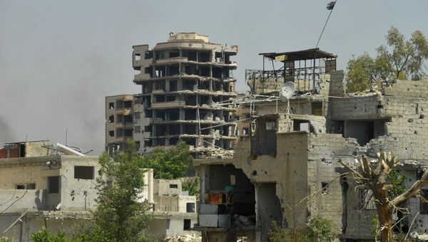 Разрушенные здания в пригороде Дамаска. Архивное фото