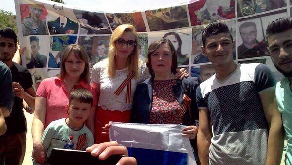 Акция Бессмертный полк с портретами погибших в Сирии российских военнослужащих в Хомсе