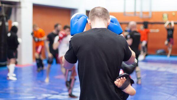 Тренировка в школе боевых искусств. Архивное фото