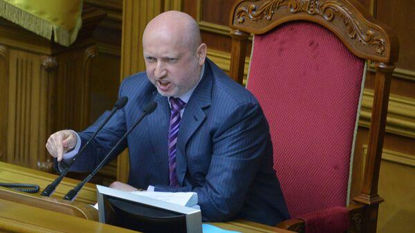 Назначенный Верховной Радой исполняющим обязанности президента Украины Александр Турчинов на заседании Верховной Рады Украины. 3 июня 2016