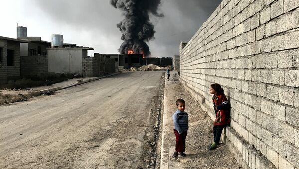 Работа фотографа из Нью-Йорка Sebastiano Tomada Children of Qayyarah, получившая Гран-при в номинации Фотограф года в iPhone Photography Awards 2017