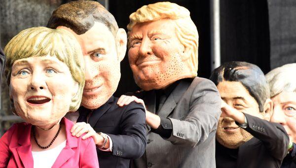 Демонстранты изображают лидеров G20 на митинге в Гамбурге. 2 июля 2017