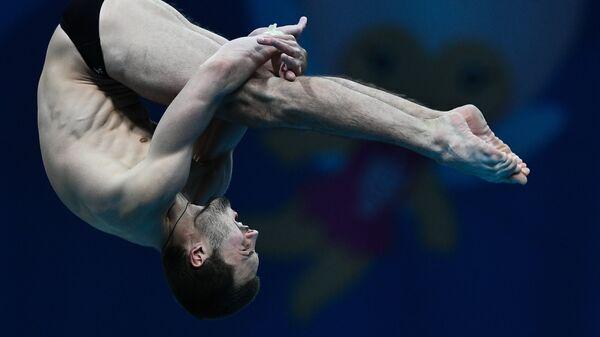 Александр Бондарь (Россия) в финальных соревнованиях по прыжкам в воду с вышки 10 м среди мужчин на XVII чемпионате мира по водным видам спорта в Будапеште