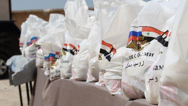 Гуманитарная помощь жителям поселения Арран на севере-востоке Алеппо. Архивное фото