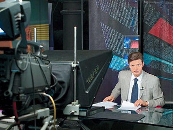 Алексей Воробьев ведет новости RTVi