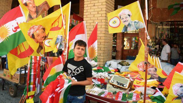 Продавец символики на рынке в Эрбиле. Архивное фото