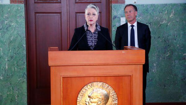 Глава Норвежского нобелевского комитета Берит Реисс-Андерсен объявляет лауреата Нобелевской премии мира за 2017 год. 6 октября 2017