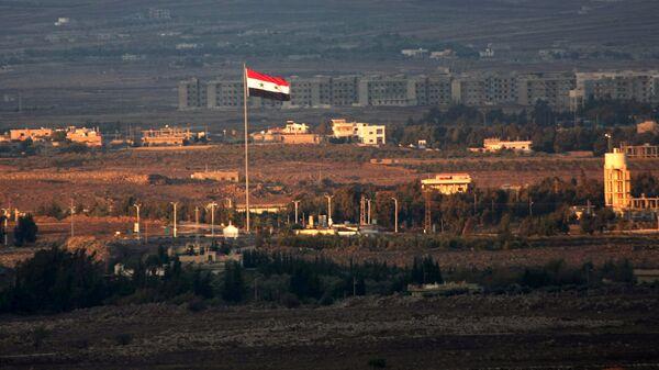 Сирийский флаг в районе Голанских высот