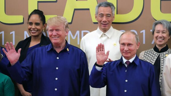 Президент РФ Владимир Путин и президента США Дональд Трамп. Архивное фото