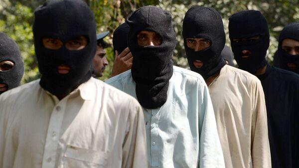 Боевики ИГ (террористическая организация, запрещена в РФ) и движения Талибан в полицейском отделении в Афганистане