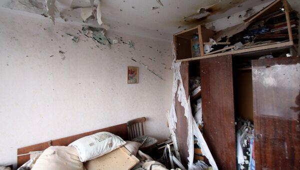 Комната в жилом доме в центре города Ясиноватая, пострадавшем в результате обстрела. 21 декабря 2017