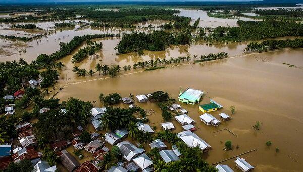 Затопленная часть муниципалитета Кабакан на южном острове Минданао, Филиппины. Архивное фото