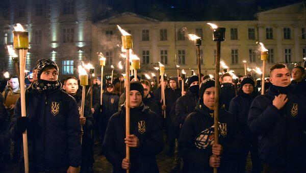 Юные участники марша националистов, приуроченного к 109-й годовщине со дня рождения Степана Бандеры, во Львове