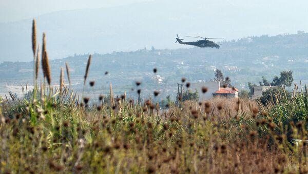 Российский вертолет Ми-24 патрулирует окрестности авиабазы Хмеймим, Сирия. Архивное фото