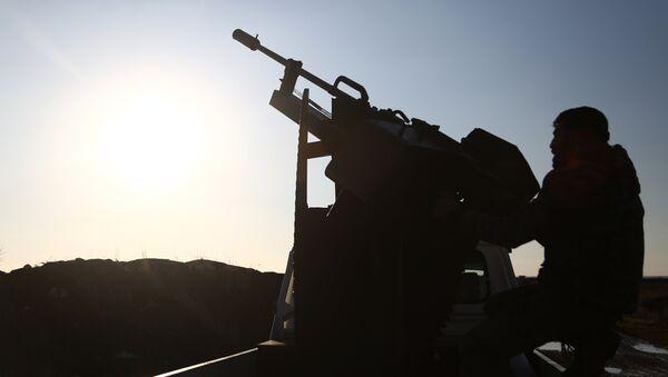 Бойцы Свободной сирийской армии занимают позиции в районе города Тал Малид