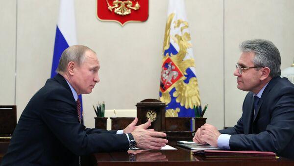 Президент РФ Владимир Путин и президент Российской академии наук Александр Сергеев во время встречи. 22 января 2018