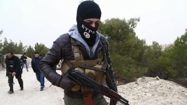 Поддерживаемые Турцией бойцы в районе горы Берсая на сирийско-турецкой границе