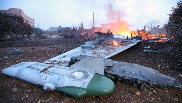 Обломки сбитого боевиками российского самолета Су-25 в Сирии. 3 февраля 2018