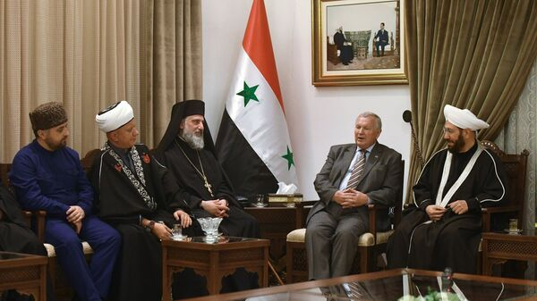 Верховный муфтий Сирии Ахмад Бадреддин Хассун во время встречи с межконфессиональной делегацией религиозных деятелей из России в Дамаске. 5 февраля 2018