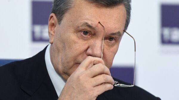Бывший президент Украины Виктор Янукович на пресс-конференции в Москве. Архивное фото