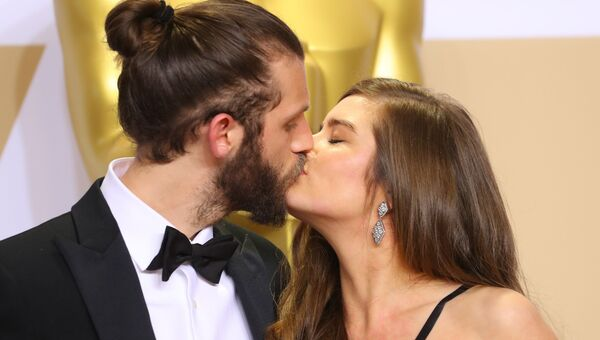 Крис Овертон и Рейчел Шентон на церемонии вручения премии Оскар