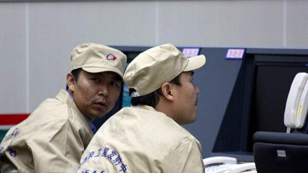 Сотрудники центра управления полетами в Китае. Архивное фото