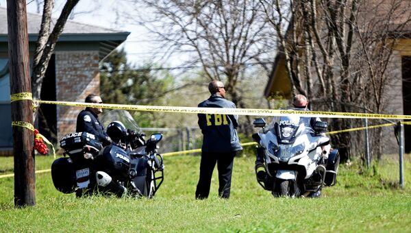Полиция и сотрудники ФБР в Остине, где произошли взрывы в частных домах, штат Техас. 12 марта 2018