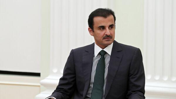 Эмир государства Катар шейх Тамим бен Хамад Аль Тани во время встречи с президентом РФ Владимиром Путиным. 26 марта 2018