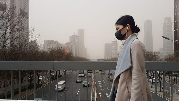 Смог на улице города Пекин, Китай. 28 марта 2018