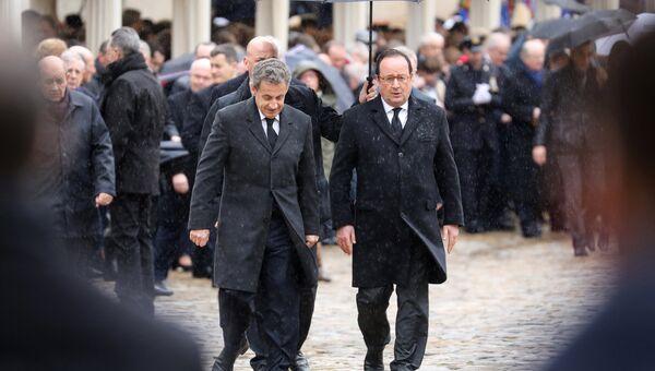 Бывшие президенты Франции Франсуа Олланд и Николя Саркози на церемонии прощания с подполковником жандармерии Арно Бельтрамом в Париже