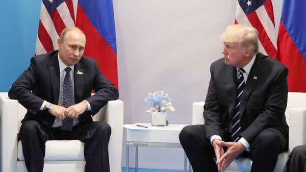Владимир Путин и Дональд Трамп. Архивное фото