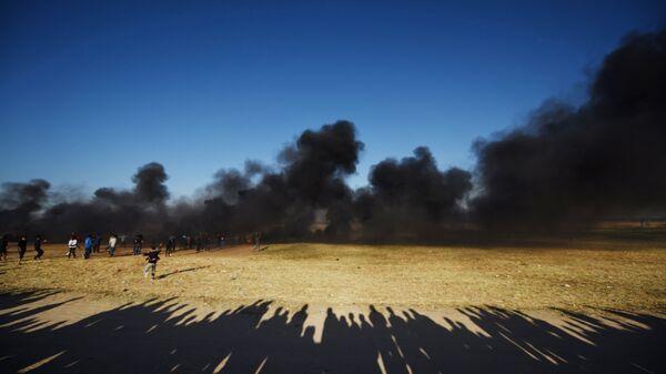 Палестинские протестующие на границе сектора Газа и Израиля.