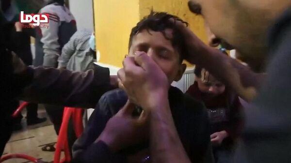 Стоп-кадр из видеорепортажа Белых касок о предполагаемой химической атаке в Думе