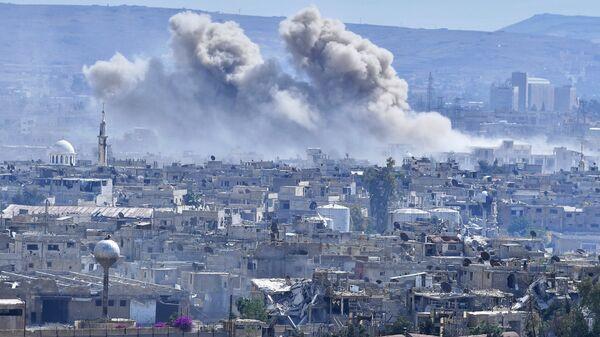 Горящие дома в пригороде Дамаска