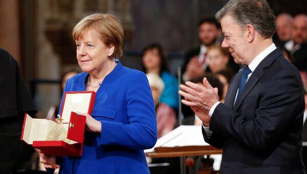 Канцлер ФРГ Ангела Меркель получила в итальянском Ассизи Лампаду святого Франциска. 12 мая 2018