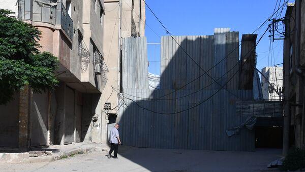 Ситуация в районе лагеря беженцев Ярмук в южном пригороде Дамаска. Архивное фото