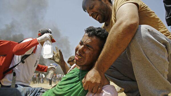 Пострадавшие в столкновениях с израильскими военными на границе сектора Газа с Израилем