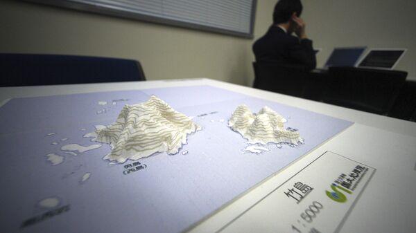 3-D карта островов  Такэсима (Токто), оспариваемых Японией и Южной Кореей, в Национальном музее территории и суверенитета в Токио
