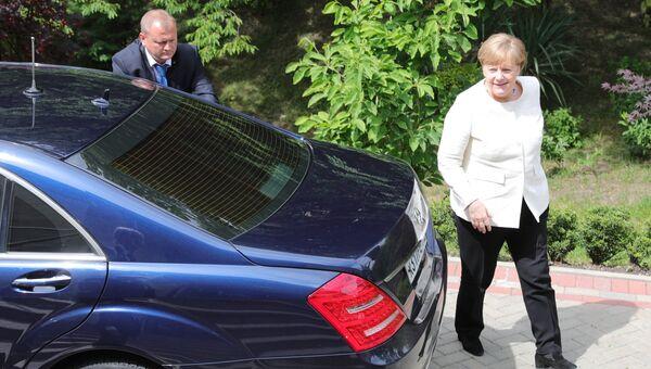 Федеральный канцлер ФРГ Ангела Меркель перед началом встречи с президентом РФ Владимиром Путиным в Сочи. 18 мая 2018