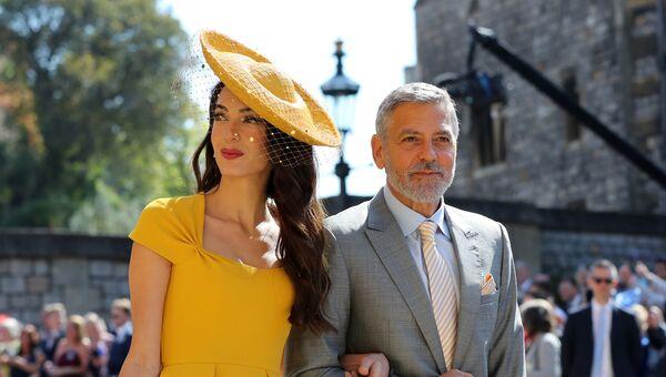 Амаль Клуни и американский актер Джордж Клуни прибывают на свадебную церемонию британского принца Гарри, герцога Сассекса и актрисы США Меган Маркл