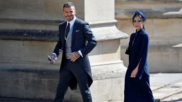 Бывший футболист сборной Англии Дэвид Бекхэм и модель Виктория Бекхэм прибывают на церемонию бракосочетания британского принца Гарри и актрисы США Меган Маркл