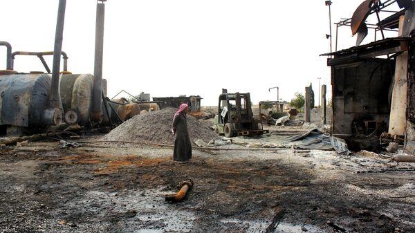 Разрушенный нефтеперерабатывающий завод в Сирии