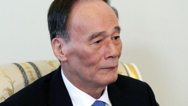 Заместитель председателя Госсовета КНР Ван Цишань. Архивное фото