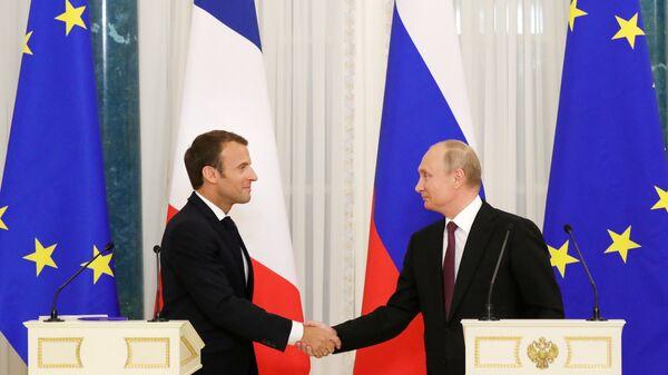 Президент России Владимир Путин и президент Франции Эммануэль Макрон на пресс-конференции по итогам встречи. 24 мая 2018