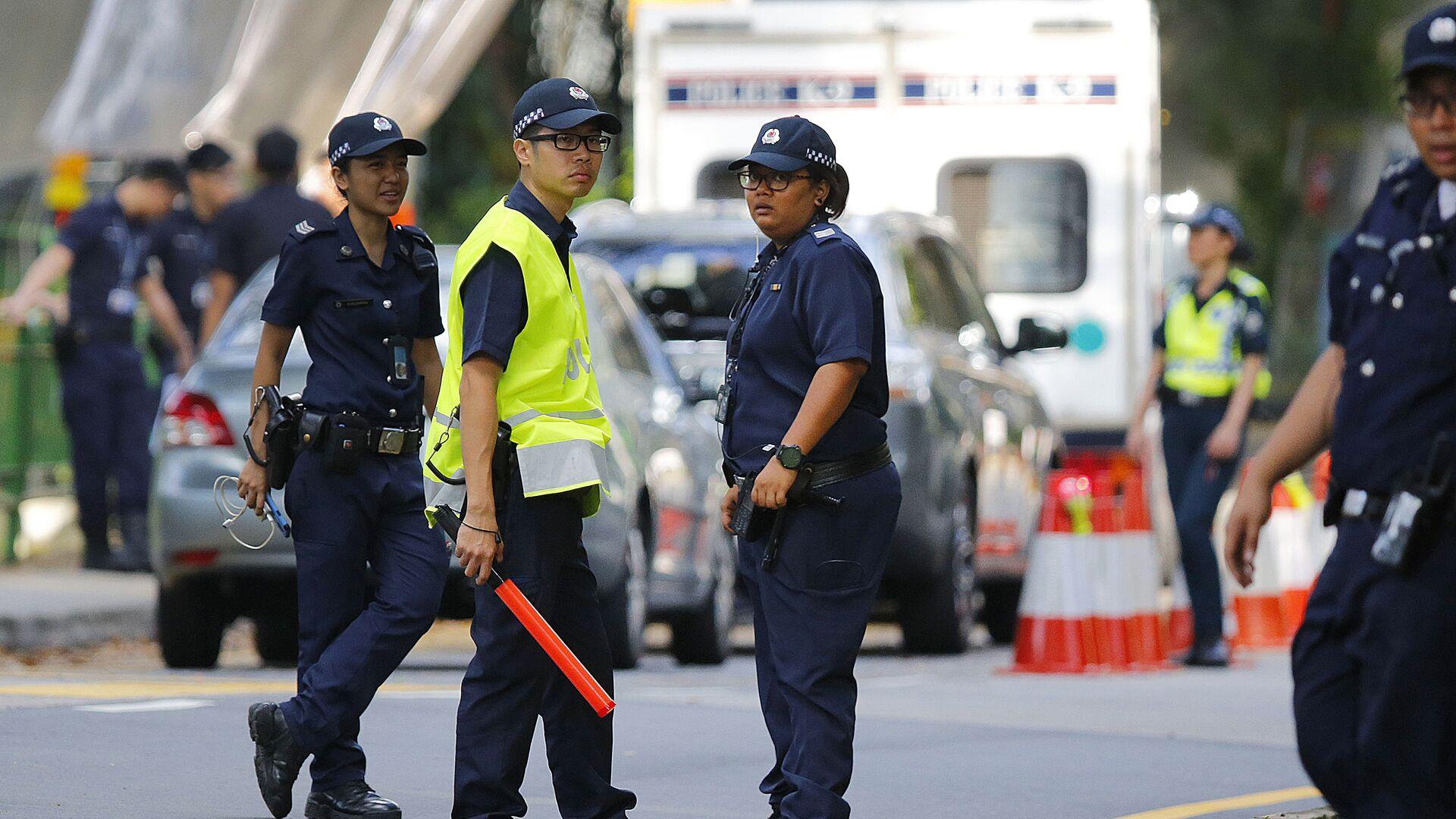 Полицейские на улице Сингапура - РИА Новости, 1920, 04.12.2020