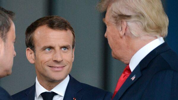 Президент Франции Эммануэль Макрон и президент США Дональд Трамп на саммите НАТО в Брюсселе. 11 июля 2018