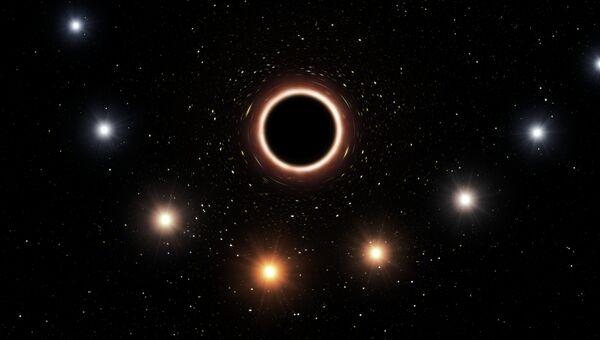 Так художник представил себе то, как меняется цвет звезды под действием гравитации черной дыры