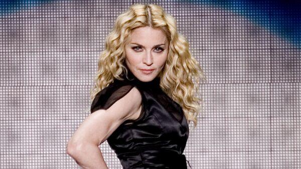 Американская певица Мадонна во время своего тура Sticky and Sweet в Мехико. 29 ноября 2008 года
