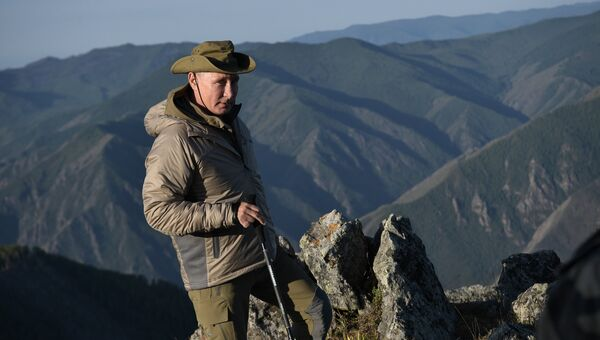 Президент РФ Владимир Путин во время отдыха в Саяно-Шушенском заповеднике в Республике Тыва. 26 августа 2018
