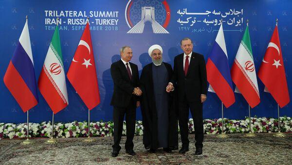 Президент России Владимир Путин, Иран Хасан Рухани и Турции Реджеп Тайип Эрдоган во время встречи в Тегеране. 7 сентября 2018